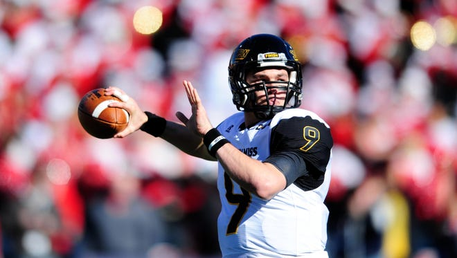 Southern Miss quarterback Nick Mullens (9) was voted as the C-USA Preseason Offensive Player of the Year for 2016.