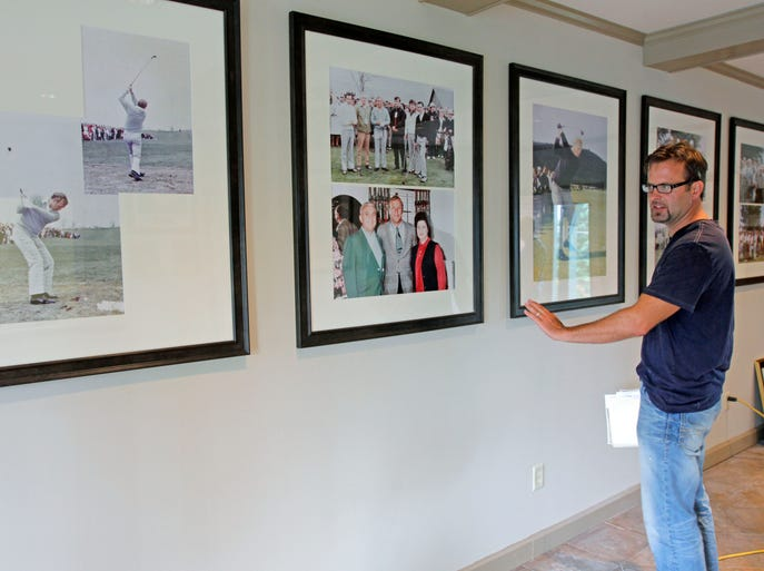 As work nears completion  to renovate the main entrance to the Mark Twain Golf Course clubhouse, Brian Beasley, superintendent of buildings and grounds for the City of Elmira, explains how display cases will be constructed for newspaper clippings chronicling the golf course's history.