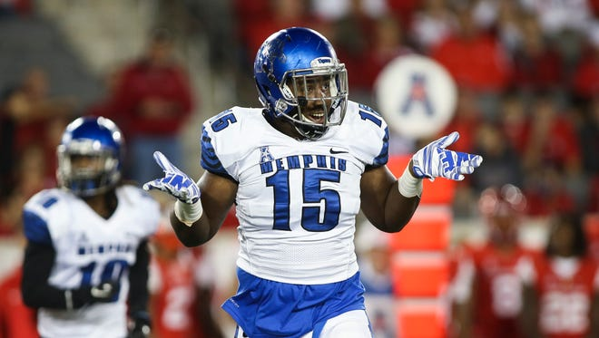 Memphis Tigers defensive end Christian Johnson (15) celebrates after making a sack against the Houston Cougars during the first quarter at TDECU Stadium.