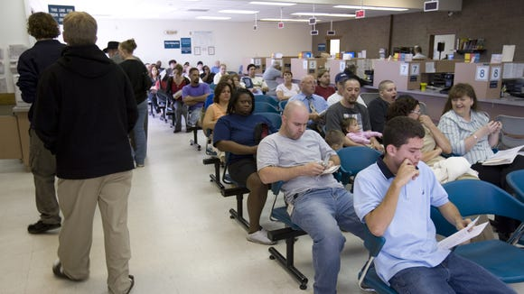 People waiting at the  Motor Vehicle Division