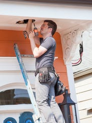 Jonathan Scott working on the exterior of the newly