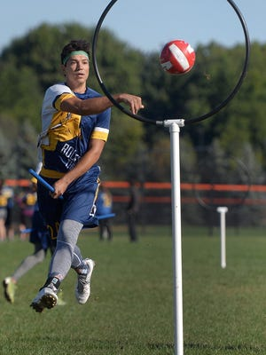 Basem Ashkar of the Rochester Thestrals (University of Rochester) scores a goal during a match against Geneseo during a Quidditch tournament held at RIT on Sunday, Sept. 25, 2016.
