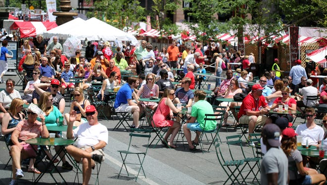 Large crowds were already evident mid-day Saturday at Taste of Cincinnati.