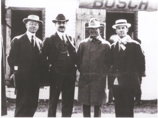 The only known photograph of the original four investors in the Indianapolis Motor Parkway: Arthur Newby (from left), Frank Wheeler, Carl Fisher (the brains behind the idea) and James Allison.