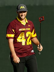 Jon Rahm wears a Pat Tillman No. 42 Arizona State football