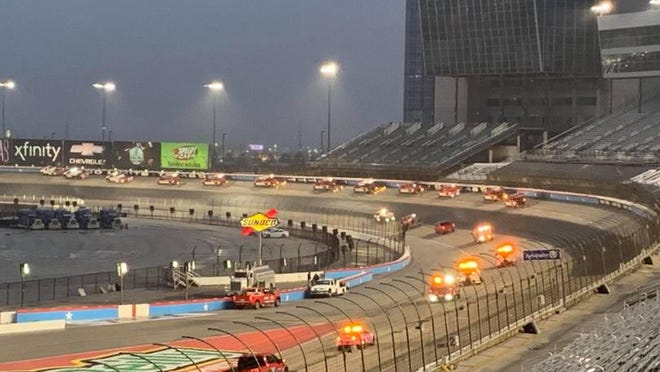Crews at Texas Motor Speedway attempt track-drying efforts in this photo taken by Steve Barkdoll from the spotters' stand.
