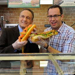 New York, NY, U.S.A  -- Fred DeLuca, founder of Subway, with Jared S. Fogle, spokesman for Subway, making sandwiches.   --    Photo by Robert Deutsch, USA TODAY staff ORG XMIT:  RD 130997 Fred DeLuca, fou 5/6/2014 [Via MerlinFTP Drop]