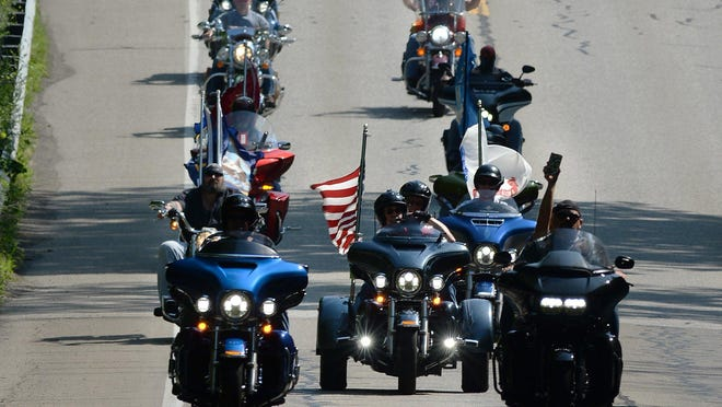 Nation of Patriots motorcyclists head west on Route 5 in Fairview Township during the Patriot Tour on July 17. More than 100 bikers left Harley-Davidson of Erie headed to Mentor, Ohio. In its 11th year, the 110-day, 14,500-mile ride will continue through 20 remaining states with a final destination of Scottsdale, Arizona, on Sept. 12.