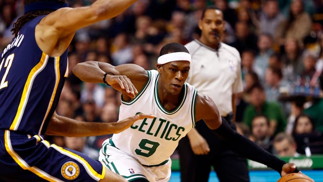 Nov 7, 2014; Boston, MA, USA; Boston Celtics guard Rajon Rondo (9) drives to the hoop against Indiana Pacers forward Chris Copeland (left) during the first half at TD Garden. Mandatory Credit: Mark L. Baer-USA TODAY Sports