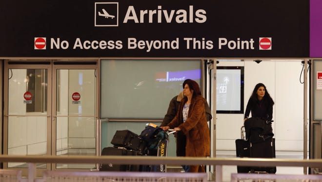 Passengers arrive through the US Customs gate at Logan International Airport in Boston. U.S. travel executives are trying to encourage more international visitors.