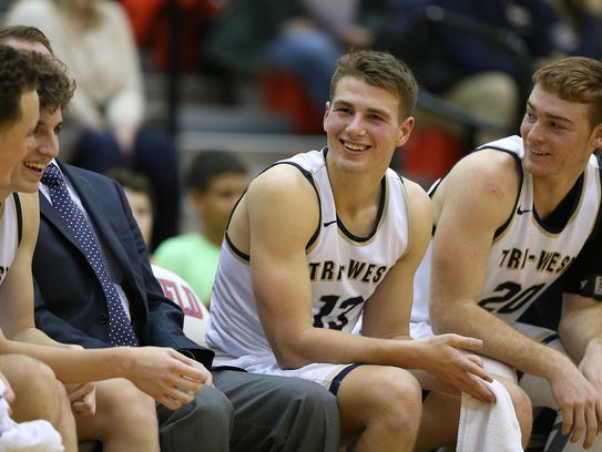 Tri-West Bruins guard Tyler Watson (13) smiles from