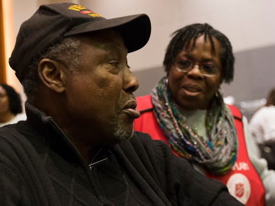 Richard Douglas talks with chaplain Carol Knox (right) at the Salvation Army Christmas Family Feast.