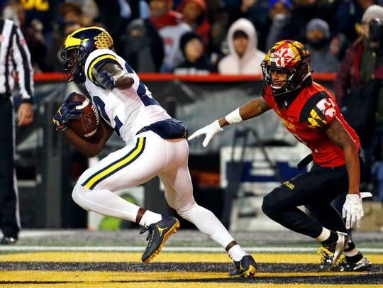Michigan's David Long intercepts a pass attempt against Maryland last season.