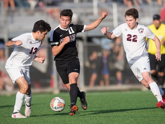 Calallen's Cesar Garcia and Veterans Memorial Carlos Elizondo fight for the ball during the District 30-5A championship game at Cabaniss Soccer Field on Friday, Match 23, 2018.