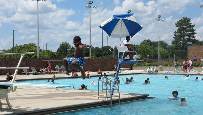 Kids and adults are cooling off in the Olympic-sized Southfield Sports Arena outdoor swimming pool, as well as the children's spray pool.