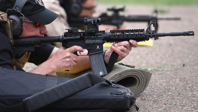 U.S. Customs and Border Protection agents fire M4 rifles during a qualification test at a shooting range on February 22, 2018 in Texas.