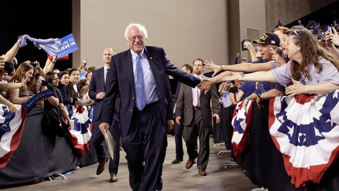 Bernie Sanders greets supporters as he arrives for a rally in Baltimore on April 23, 2016.