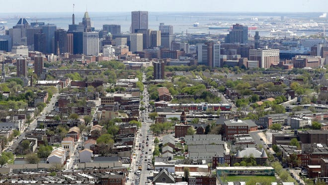 """An aerial view of Baltimore in 2015. The Baltimore Overdose Fatality Review Team meets each month in a private room. """"We look at treatment history, incarceration, interactions with hospitals, arrests. We look at every interaction with different public systems as an opportunity for intervention or engagement,"""" said Adrienne Breidenstine, spokeswoman for Behavioral Health System Baltimore."""