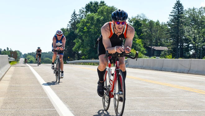 Athletes on the bike portion of the race during the Graniteman Clearwater Triathlon Saturday, July 14, at Warner Lake Park in Clearwater.