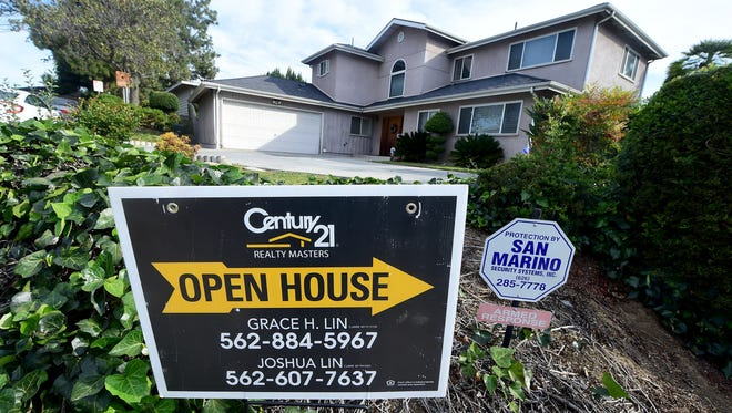 An Open House sign directs prospective buyers to property for sale in Monterey Park, California on April 19, 2016.