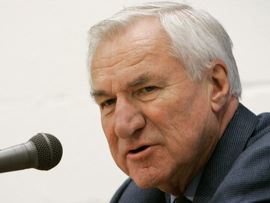 In this Dec. 8, 2006, file photo, former North Carolina basketball coach Dean Smith answers questions during a news conference.