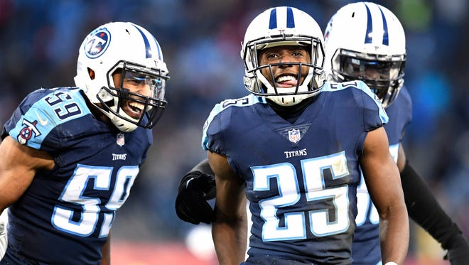 Titans cornerback Adoree' Jackson (25) and linebacker Wesley Woodyard (59) celebrate the fumble recovery by linebacker Jayon Brown (55) after Jackson punched the ball loose from Jaguars wide receiver Keelan Cole (84) during the second quarter at Nissan Stadium Sunday, Dec. 31, 2017 in Nashville, Tenn.