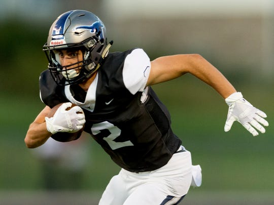 Anderson County's Michael Carroll (2) runs the ball during a game between Anderson County and Heritage at Anderson County High School in Clinton, Tennessee on Friday, September 22, 2017.