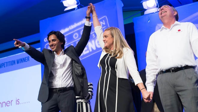Kunal Sarda, co-founder of VerbalizeIt, is declared the winner of the $250,000 CSU Blue Ocean Enterprises Challenge by emcee Charisse Bowen May 30 at the Lory Student Center.