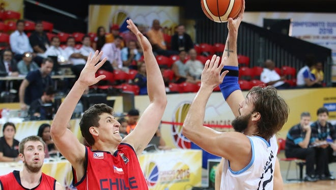 CSU redshirt freshman Nico Carvacho (14) attempts to block a shot during the 2016 FIBA South American Championship in Caracas, Venezuela.