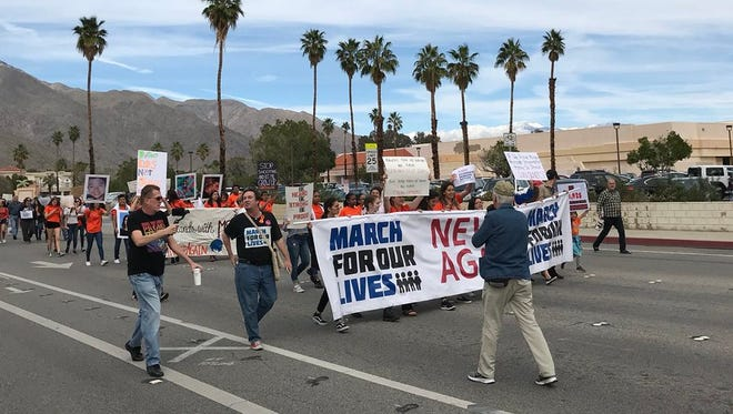 Students depart Palm Springs High School Saturday shortly after 10:30 a.m. as part of the nationwide March For Our Lives demonstration against gun violence in this country.