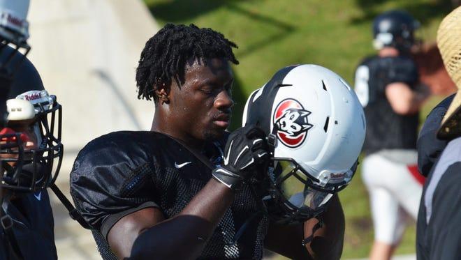 St. Cloud State freshman cornerback Jamari Manuel takes a break during Wednesday's practice at Husky Stadium.