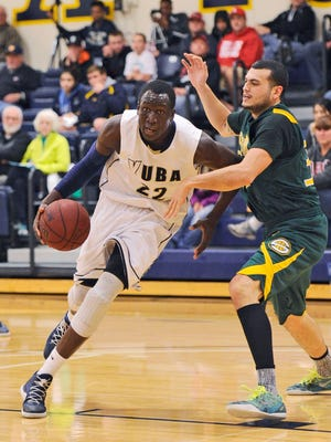 Yuba College's Emmanuel Malou drives to the basket during a Jan. 17, 2015, game against Napa Valley College  in Marysville, Calif.
