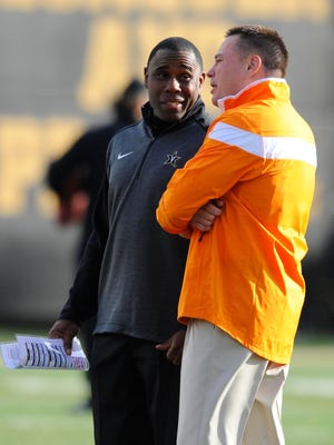 Vanderbilt's Derek Mason, left, and Tennessee's Butch Jones