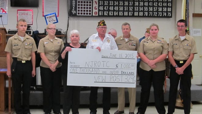 Veterans of Foreign Wars Post Ozark 3246 awards Mountain Home Navy Junior ROTC $1,000 for uniform needs. Shown are: from left, Anthonee Giarriri and Angel LeBlanc, NJROTC cadets; Kathy Sisney, VFW Auxiliary president; Bill Bradford, VFW commander; Troy Peel, NJROTC senior chief; and Bailee Carter and Brian Griesi, cadets.