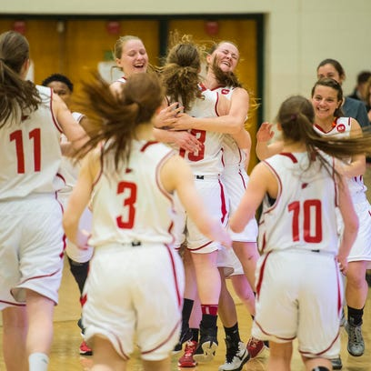 CVU players celebrate their victory over Rice during