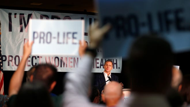 Missouri Gov. Eric Greitens speaks at a rally in support of next week's anti-abortion special session on Friday, June 9, 2017.