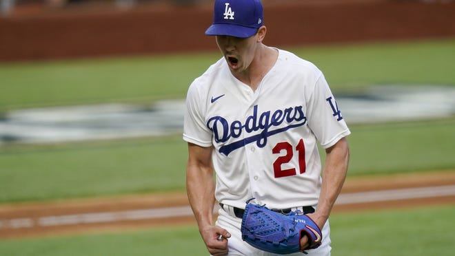 Los Angeles starting pitcher Walker Buehler celebrates after striking out Atlanta's Austin Riley during the sixth inning of Friday's game.