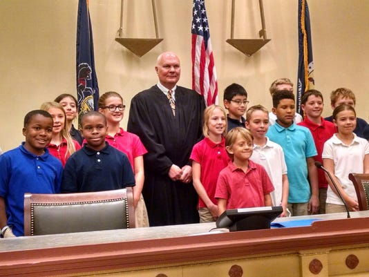 Judge John S. Kennedy stands with fifth-graders from York Country Day School. (submitted)