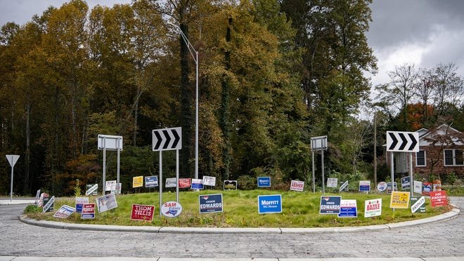 Political signs line a roundabout on Greenville Highway in Hendersonville on Oct. 12.