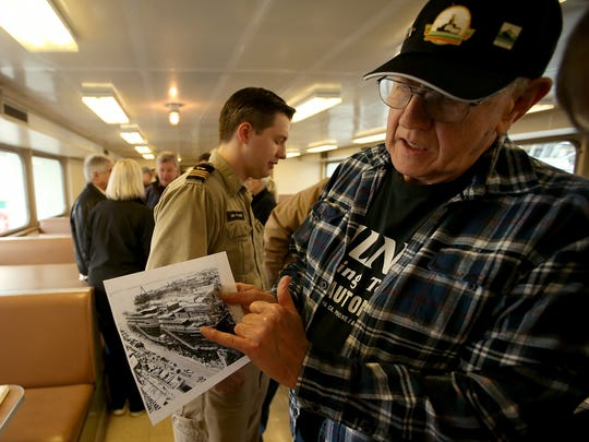 John Milner looks over an archival photo depicting the four superferries being built at National Steel and Ship Building in San Diego. Milner was on hand to celebrate the 50th birthday of the ferry Hyak on Thursday at Eagle Harbor Maintenance Facility.