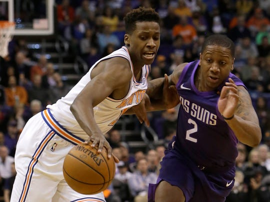 New York Knicks guard Frank Ntilikina and Phoenix Suns guard Isaiah Canaan (2) vie for the ball during the first half of an NBA basketball game Friday, Jan. 26, 2018, in Phoenix.