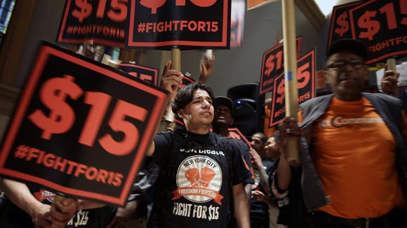 Demonstrators rally for a $15 minimum wage before a meeting of the state Wage Board in New York on June 15.