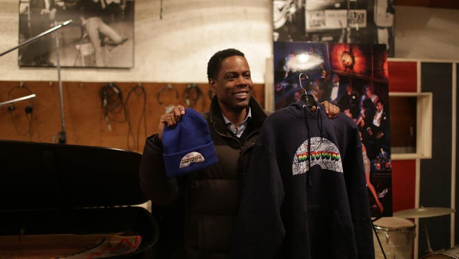 Comedian Chris Rock poses for cameras briefly while making a visit to the Motown Museum in Detroit on Wednesday December 10, 2014 promoting his new movie Top Five. Rock is going to five cities, five screenings and five landmarks in one day.