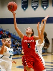 Oakland's Faith Adams (2) goes up for a shot during the game against Siegel on Tuesday, Dec. 5, 2017, at Siegel.