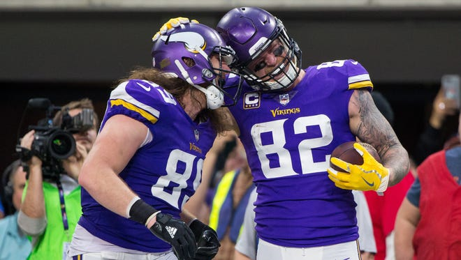 Minnesota Vikings tight end Kyle Rudolph (82) celebrates his touchdown with tight end David Morgan II (89) in the fourth quarter against the Cincinnati Bengals at U.S. Bank Stadium.