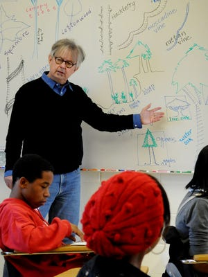 In this file photo, Caddo Magnet teacher, Robert Trudeau, goes over what is to be expected to see when they go on the Coates Bluff Nature Trail behind their school.Trudeau has announced his retirement.