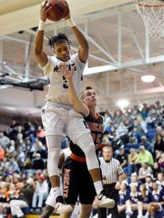Dallastown's Justin Atwood grabs a rebound against