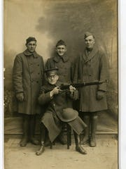 Regulars with the classic World War I U.S. weapon, the model 1903 Springfield rifle.
