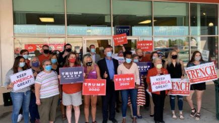 State Treasurer Robert Sprague, in the middle with the dark blue suit and light blue mask, visits Donald Trump's re-election office Monday in Kettering, a Dayton suburb. It's the most visible activity of any statewide GOP official this week during the Republican National Convention.