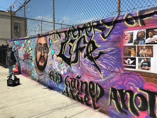 "A memorial to shooting victim Juan Martinez, known as ""Life,"" near Essex and Madison streets in Paterson. The mural was painted shortly after his May 1 killing, but has since been painted over."